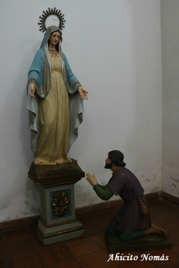 Pidiendo a la virgen